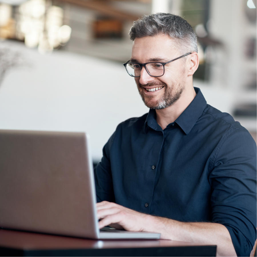 Photo of a man using his computer