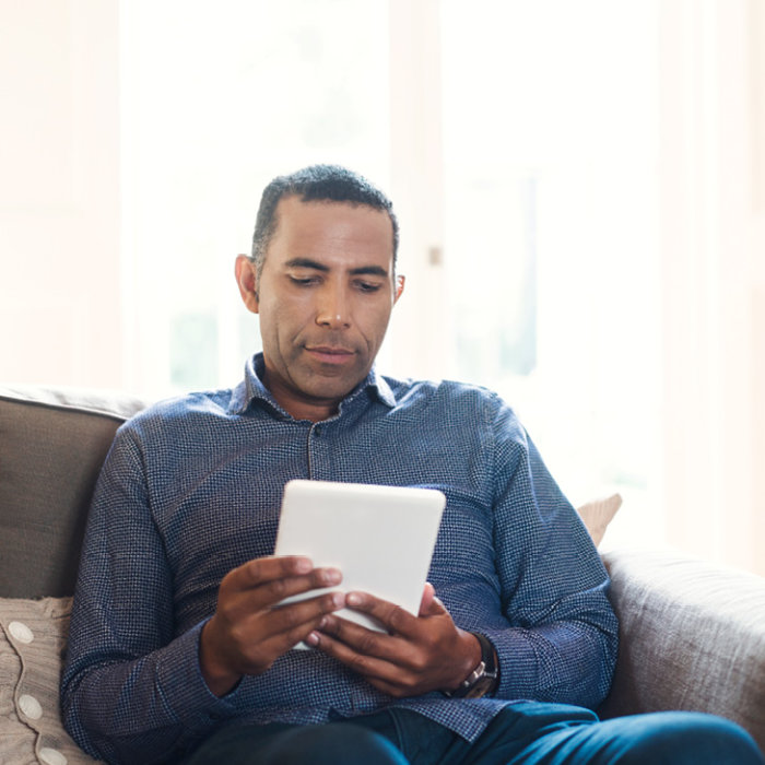 Photo of a man using a tablet